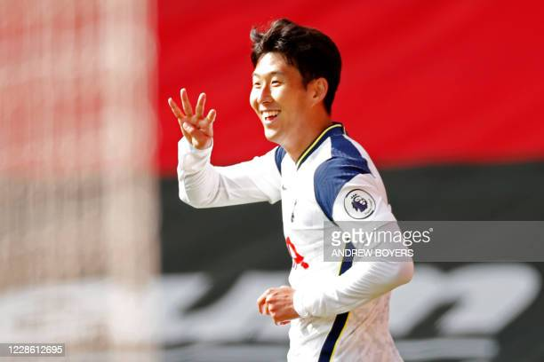 Tottenham Hotspur's South Korean striker Son Heung-Min celebrates after scoring his and their fourth goal during the English Premier League football...