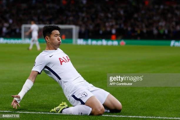 Tottenham Hotspur's South Korean striker Son HeungMin celebrates after scoring the opening goal of the UEFA Champions League Group H football match...
