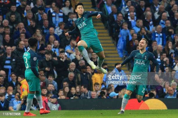 Tottenham Hotspur's South Korean striker Son HeungMin celebrates scoring his team's second goal during the UEFA Champions League quarter final second...