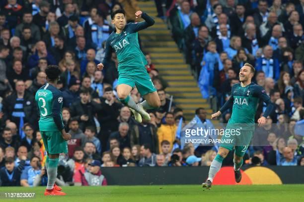 TOPSHOT Tottenham Hotspur's South Korean striker Son HeungMin celebrates scoring his team's second goal during the UEFA Champions League quarter...