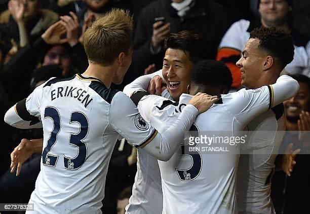 Tottenham Hotspur's South Korean striker Son Heung-Min celebrates scoring his team's second goal with Tottenham Hotspur's Argentinian midfielder...