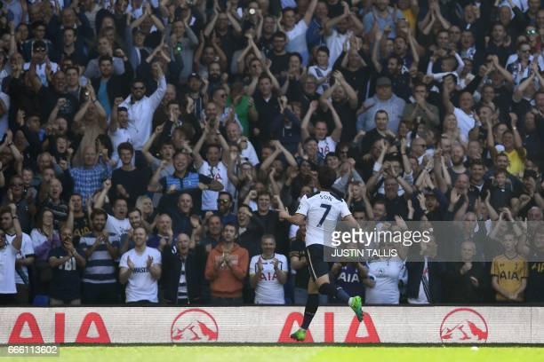 Tottenham Hotspur's South Korean striker Son HeungMin celebrates scoring his team's third goal during the English Premier League football match...