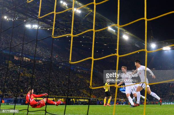 Tottenham Hotspur's South Korean striker Son HeungMin celebrates scoring past Dortmund's Swiss goalkeeper Roman Buerki with his teammate Tottenham...