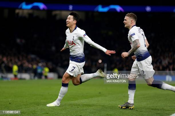 Tottenham Hotspur's South Korean striker Son HeungMin celebrates scoring the opening goal during the UEFA Champions League quarterfinal first leg...