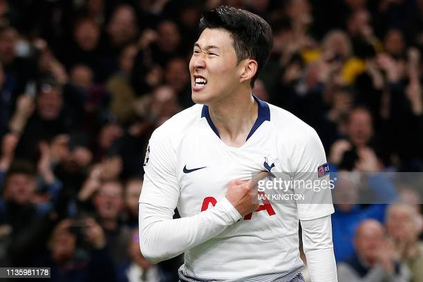 TOPSHOT Tottenham Hotspur's South Korean striker Son HeungMin celebrates scoring the opening goal during the UEFA Champions League quarterfinal first...