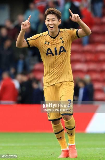 Tottenham Hotspur's South Korean striker Son HeungMin celebrates following the English Premier League football match between Middlesbrough and...