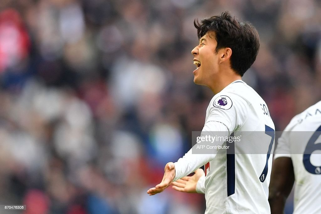 Tottenham Hotspur's South Korean striker Son Heung-Min celebrates scoring the opening goal during the English Premier League football match between Tottenham Hotspur and Crystal Palace at Wembley Stadium in London, on November 5, 2017. / AFP PHOTO / Ben STANSALL / RESTRICTED TO EDITORIAL USE. No use with unauthorized audio, video, data, fixture lists, club/league logos or 'live' services. Online in-match use limited to 75 images, no video emulation. No use in betting, games or single club/league/player publications. /