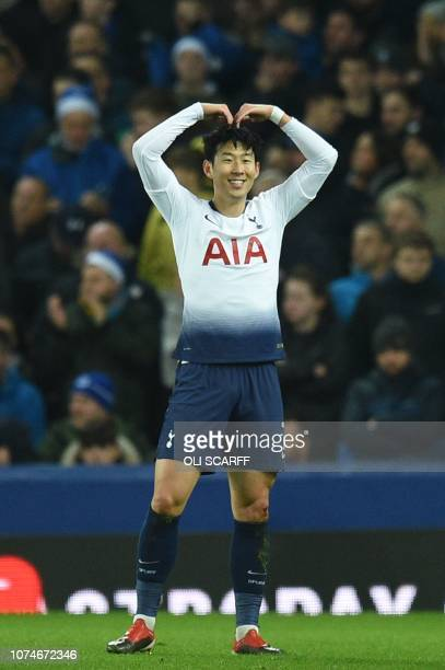 Tottenham Hotspur's South Korean striker Son HeungMin celebrates with the Mobot pose of British athlete Mo Farah after scoring their first goal...