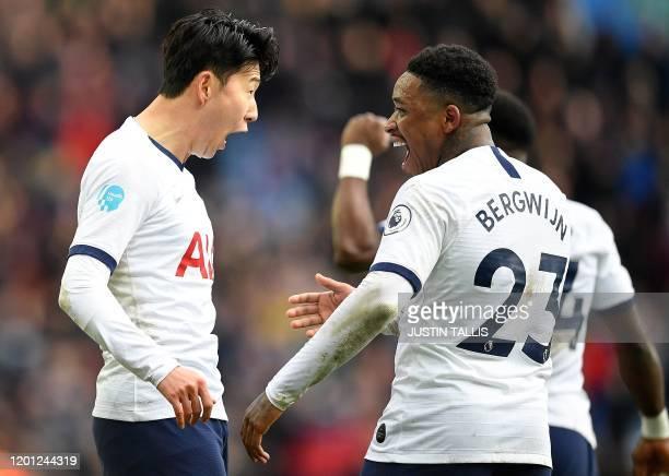 Tottenham Hotspur's South Korean striker Son HeungMin celebrates with Tottenham Hotspur's Dutch midfielder Steven Bergwijn after scoring his team's...