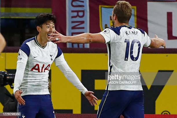 Tottenham Hotspur's South Korean striker Son HeungMin celebrates with Tottenham Hotspur's English striker Harry Kane after scoring the opening goal...