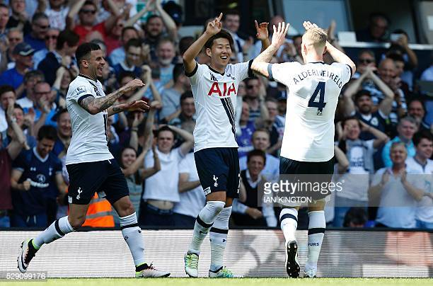Tottenham Hotspur's South Korean striker Son HeungMin celebrates with Tottenham Hotspur's Belgian defender Toby Alderweireld after scoring during the...