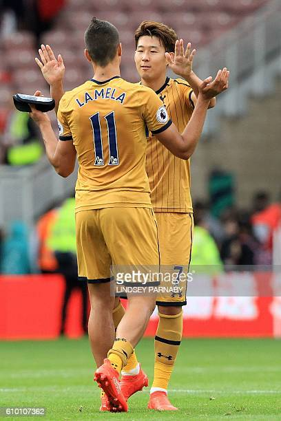 Tottenham Hotspur's South Korean striker Son HeungMin celebrates with Tottenham Hotspur's Argentinian midfielder Erik Lamela following the English...