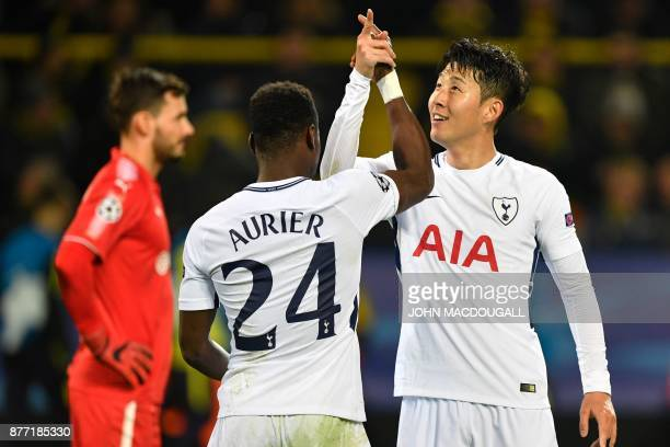 Tottenham Hotspur's South Korean striker Son HeungMin celebrates scoring with his teammate Tottenham Hotspur's Ivorian defender Serge Aurier during...