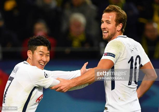 Tottenham Hotspur's South Korean striker Son HeungMin celebrates scoring with his teammate Tottenham Hotspur's English striker Harry Kane during the...