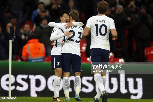 Tottenham Hotspur's South Korean striker Son Heung-Min celebrates with teammates after scoring their second goal during the English Premier League...