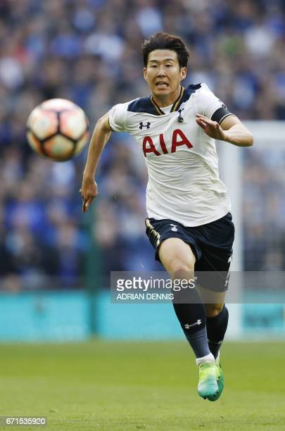 Tottenham Hotspur's South Korean striker Son HeungMin chases the ball during the FA Cup semifinal football match between Tottenham Hotspur and...