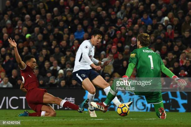 Tottenham Hotspur's South Korean striker Son HeungMin confronts Liverpool's German goalkeeper Loris Karius during the English Premier League football...