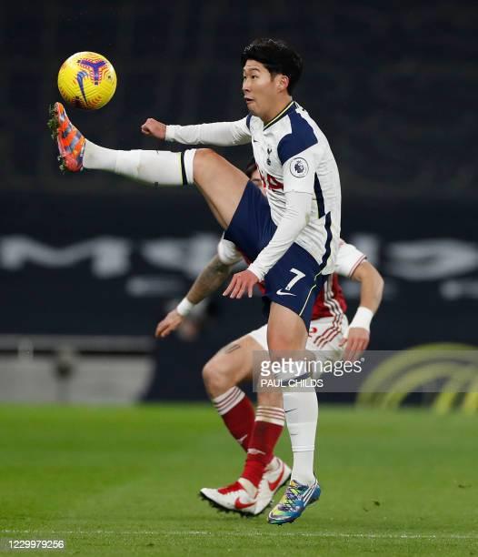 Tottenham Hotspur's South Korean striker Son Heung-Min controls the ball during the English Premier League football match between Tottenham Hotspur...