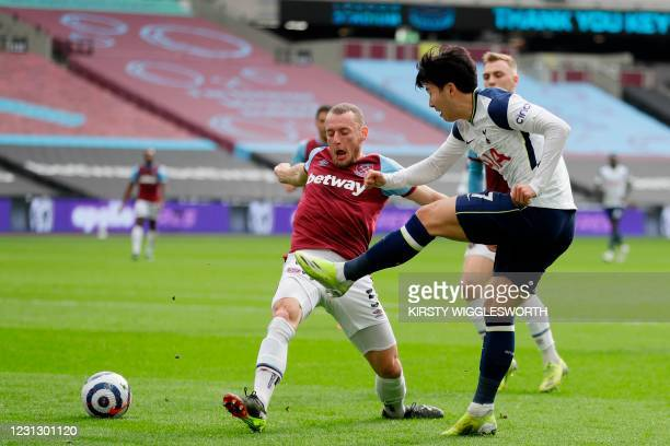Tottenham Hotspur's South Korean striker Son Heung-Min crosses the ball as West Ham United's Czech defender Vladimir Coufal defends during the...