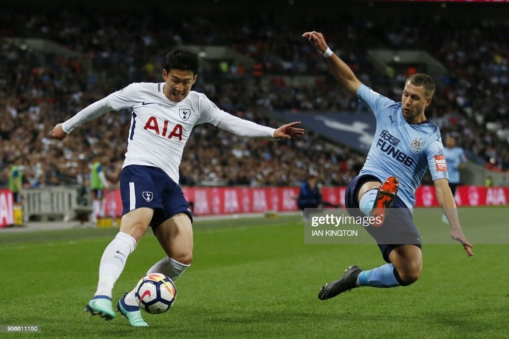Tottenham Hotspur's South Korean striker Son Heung-Min (L) crosses the ball by Newcastle United's French midfielder Florian Lejeune during the English Premier League football match between Tottenham Hotspur and Newcastle United at Wembley Stadium in London, on May 9, 2018. (Photo by Ian KINGTON / AFP) / RESTRICTED TO EDITORIAL USE. No use with unauthorized audio, video, data, fixture lists, club/league logos or 'live' services. Online in-match use limited to 75 images, no video emulation. No use in betting, games or single club/league/player publications. /