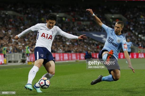 Tottenham Hotspur's South Korean striker Son HeungMin crosses the ball by Newcastle United's French midfielder Florian Lejeune during the English...