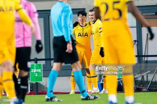 Tottenham Hotspur's South Korean striker Son Heung-Min is congratulated by Tottenham Hotspur's Welsh striker Gareth Bale after scoring the 1-2 during...