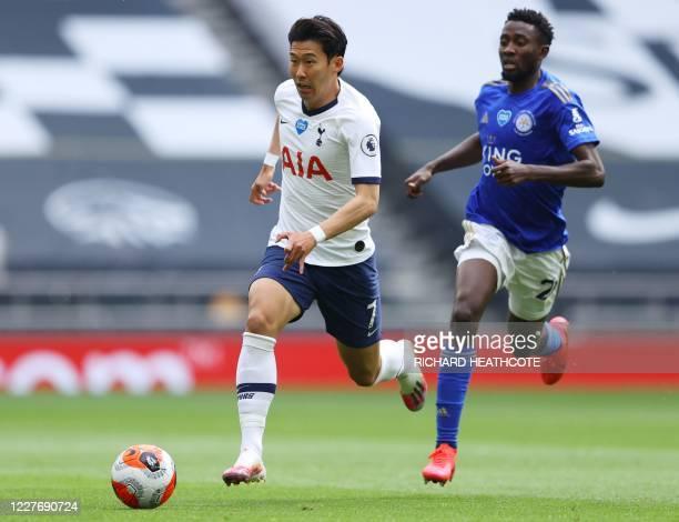 Tottenham Hotspur's South Korean striker Son Heung-Min outruns Leicester City's Nigerian midfielder Wilfred Ndidi during the English Premier League...