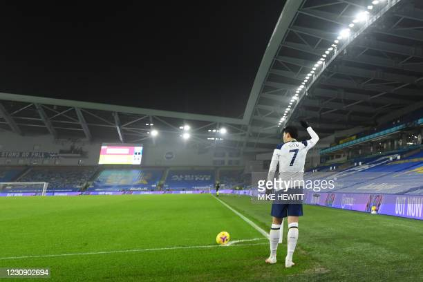 Tottenham Hotspur's South Korean striker Son Heung-Min prepares to take a corner during the English Premier League football match between Brighton...
