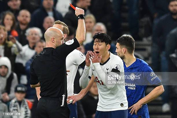Tottenham Hotspur's South Korean striker Son HeungMin reacts after being shown a red card by English referee Anthony Taylor during the English...