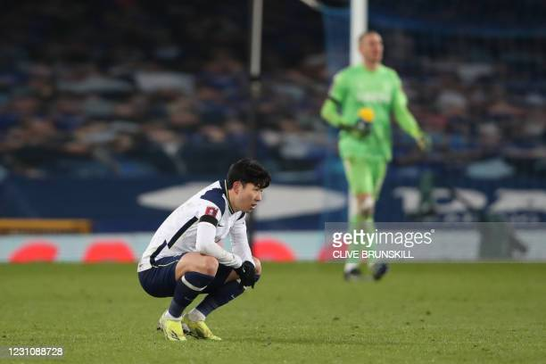 Tottenham Hotspur's South Korean striker Son Heung-Min reacts at the final whistle during the English FA Cup fifth round football match between...