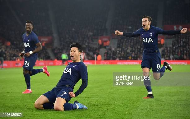 TOPSHOT Tottenham Hotspur's South Korean striker Son HeungMin runs to celebrate after scoring the opening goal during the English FA Cup fourth round...