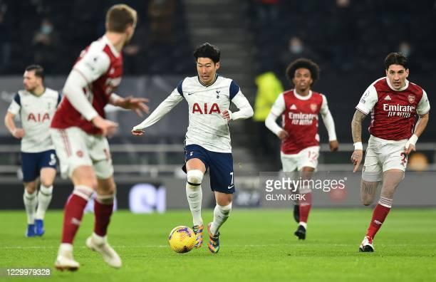 Tottenham Hotspur's South Korean striker Son Heung-Min runs with the ball during the English Premier League football match between Tottenham Hotspur...