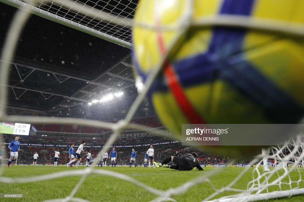 TOPSHOT - Tottenham Hotspur's South Korean striker Son Heung-Min scores a penalty which is disallowed during the English FA Cup 5th round replay football match between Tottenham Hotspur and Rochdale at Wembley Stadium in London, on February 28, 2018. / AFP PHOTO / Adrian DENNIS / RESTRICTED TO EDITORIAL USE. No use with unauthorized audio, video, data, fixture lists, club/league logos or 'live' services. Online in-match use limited to 75 images, no video emulation. No use in betting, games or single club/league/player publications. /