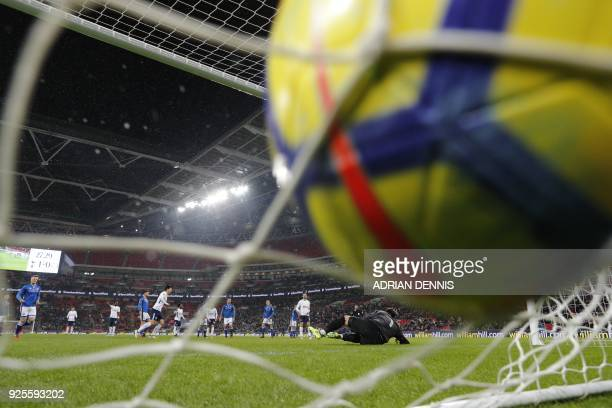 TOPSHOT Tottenham Hotspur's South Korean striker Son HeungMin scores a penalty which is disallowed during the English FA Cup 5th round replay...