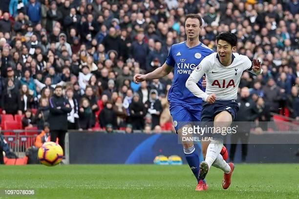 Tottenham Hotspur's South Korean striker Son HeungMin scores his team's third goal during the English Premier League football match between Tottenham...