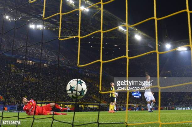 Tottenham Hotspur's South Korean striker Son HeungMin scores past Dortmund's Swiss goalkeeper Roman Buerki during the UEFA Champions League Group H...