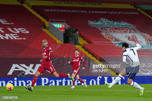 Tottenham Hotspur's South Korean striker Son Heung-Min scores the equalising goal during the English Premier League football match between Liverpool...