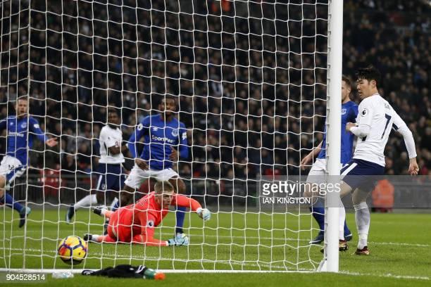 Tottenham Hotspur's South Korean striker Son HeungMin scores the team's frist goal during the English Premier League football match between Tottenham...
