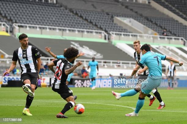 Tottenham Hotspur's South Korean striker Son HeungMin shoots to score the opening goal of the English Premier League football match between Newcastle...