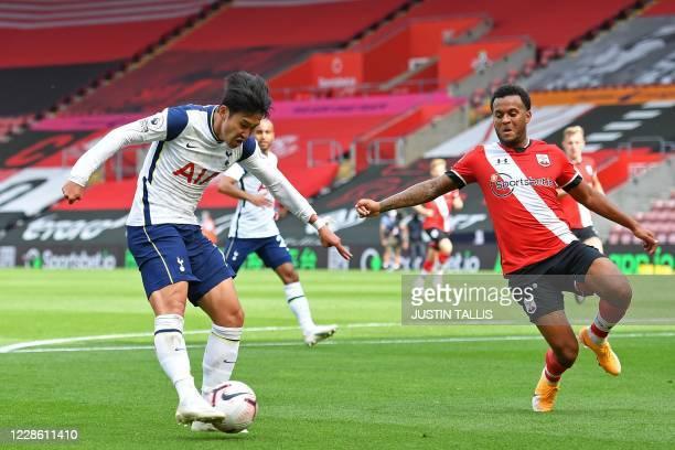 Tottenham Hotspur's South Korean striker Son Heung-Min shoots to score their first goal during the English Premier League football match between...