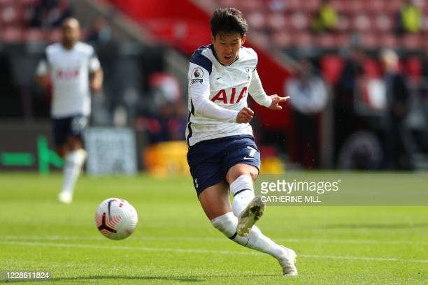 Tottenham Hotspur's South Korean striker Son Heung-Min shoots to score his and their second goal during the English Premier League football match...