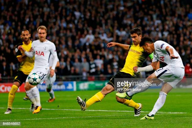 Tottenham Hotspur's South Korean striker Son HeungMin shoots to score the opening goal of the UEFA Champions League Group H football match between...