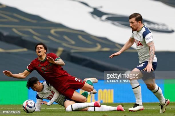 Tottenham Hotspur's South Korean striker Son Heung-Min tackles Wolverhampton Wanderers' Dutch defender Ki-Jana Hoever during the English Premier...