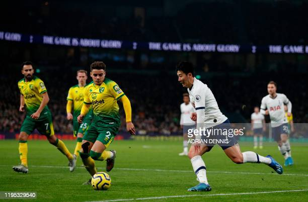 Tottenham Hotspur's South Korean striker Son HeungMin takes on Norwich City's English defender Max Aarons during the English Premier League football...