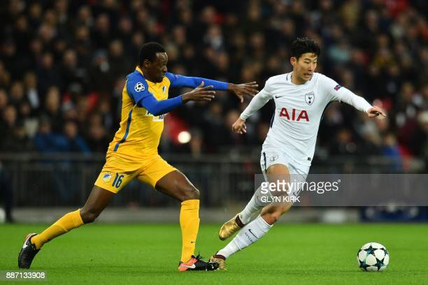 Tottenham Hotspur's South Korean striker Son HeungMin vies with Apoel Nicosia's Brazilian midfielder Vinicius during the UEFA Champions League Group...