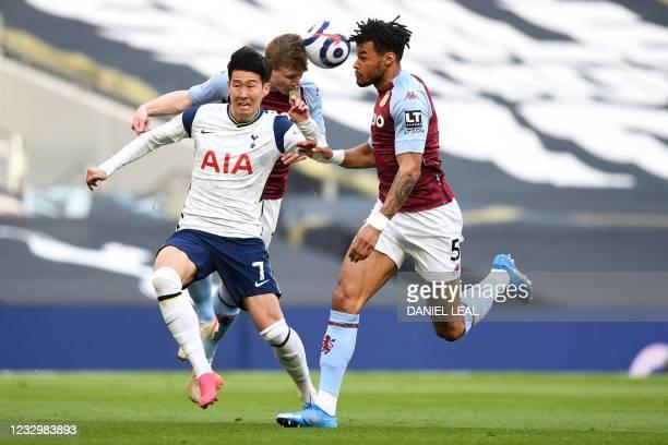 Tottenham Hotspur's South Korean striker Son Heung-Min vies with Aston Villa's English defender Tyrone Mings during the English Premier League...