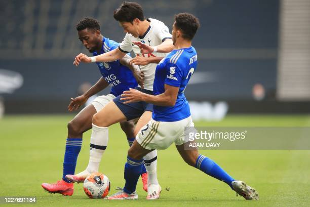 Tottenham Hotspur's South Korean striker Son Heung-Min vies with Leicester City's Nigerian midfielder Wilfred Ndidi and Leicester City's English...