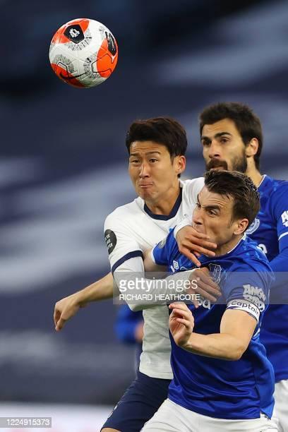 Tottenham Hotspur's South Korean striker Son Heung-Min vies with Everton's Irish defender Seamus Coleman and Everton's Portuguese midfielder André...
