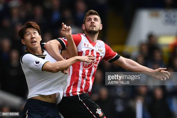 Tottenham Hotspur's South Korean striker Son HeungMin vies with Southampton's Irish striker Shane Long during the English Premier League football...