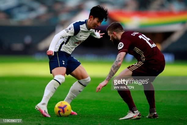 Tottenham Hotspur's South Korean striker Son Heung-Min vies with Leeds United's Northern Irish midfielder Stuart Dallas during the English Premier...